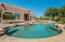 Sparkling pool with elevated spa and spillway for hours of backyard fun!