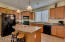 Granite counter tops, pendant lighting, 3D staggered cabinets....