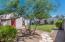 Rear yard, full yard, desert border, guest house and garage.