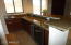 Wet Bar with sink and wine fridge.