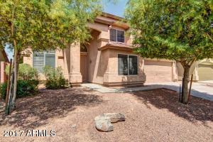 Welcome home ! This 5 bedroom 3 bath home with a pool has easy care desert front yard landscaping.
