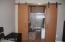 Custom Sliding doors lead to master bathroom