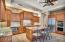 Kitchen with sit down bar island and new Stainless Steel Appliances