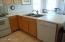 Dishwasher & stainless steel sink.