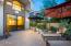 fully tiled backyard patio area