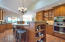 Entertainer's kitchen with bar area and vaulted ceiling