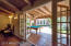 Four-panel French doors lead to large covered patio