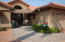 Lovely entryway with pavers and metal Pergola