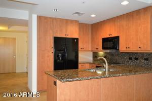 Kitchen has upgraded cabinets and granite counter tops