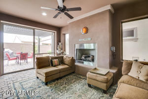 Beautiful screened in back patio with fireplace.