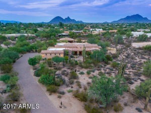Single level custom home on 2.5 acres with a 4830sf main house and 1354sf guest house.