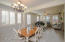 Grand entry flows into formal dining and living room (wired for surround sound)