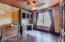 """The classic office features wood flooring, a """"Pressed tin"""" look ceiling, and a walk in closet for plenty of storage."""