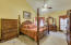 Huge master suite holds this large bedroom set comfortably. Note the Vaulted Ceilings.