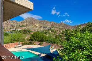 Private diving pool and spa showcase views in every direction!