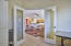 Tempered glass doors, ceiling fan, tile floor