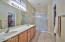 2 sinks, plantation shutters, shower with rain glass enclosure,cultured marble surround. walk in closet