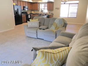 Spacious great room overlooking the kitchen and dining area with all tile for easy maintenance.