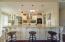 Massive kitchen island and beautifully-finished kitchen