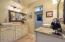 Separate raised vanities with vessel sinks