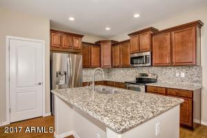 "Upgraded 42"" staggered cabinets & full granite backsplash."