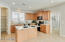 spacious kitchen with island and breakfast bar