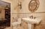 Jack & Jill Bathroom, Custom Paint, Travertine Tile Surrounds, Upgraded Plumbing & Light Fixtures
