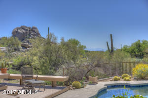 "Private Lot Joins Scenic Desert, Golf Course and Views of ""Boulderpile"""