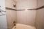 TILED SHOWER AND JETTED TUB