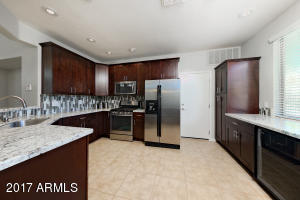 """Extended and remodeled kitchen with custom 42"""" cabinets, Whirlpool Gold Stainless Steel Appliances, incl. gas. Whirlpool Gold Stainless Steel Appliances, incl. gas stove, $1500 Marvel Wine/ Beverage Fridge"""