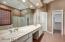 Lovely master bath with walk in closet.
