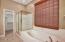 Separate soaking tub & shower.