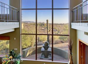 Two-story view window at the bottom of the staircase delivers inspiring views. Come see!