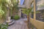 Welcoming Courtyard leads you to home and french doors to kitchen