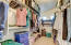 Long, rectangular walk-in closet maximizes the available space in the room.