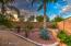 Natural desert landscaping reduces water usage.