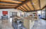 This room is amazing! Soaring beamed ceilings with tongue and groove wood planks.