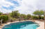 Enjoy the convenience of a private pool and privacy with natural space behind the home.