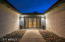 The front courtyard comes to life with industrial exterior lighting that leads you up to the 1-lite Glass French doors.