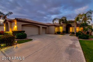 Front view at twilight. Gorgeous semi custom 3 bedroom 2 bath home in Ocotillo Lakes