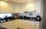 White Kitchen Cabinets, granite counters and lots of counter space