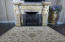 Gas fireplace with custom stone statues and mantel