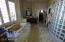 Split sinks, Jacuzzi tub and radius glass block wall to shower