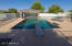 Diving pool with swim up bar, sunken grotto and water feature