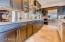 Elegant counter tops and stainless steel backsplash