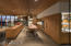 Gourmet kitchen with wood block island & island lift provision for TV