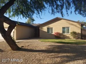 Beautiful front landscaping with mature mesquite trees and the perfect amount of grass to enjoy out front.