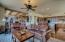 Family room off kitchen with wet bar separating formal living room and dining room