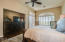 Master bedroom with access to rear yard offering gorgeous mountain views