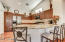 Kitchen includes a breakfast bar.